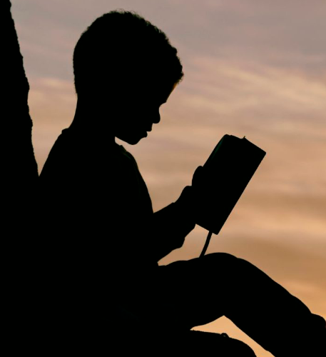 Sitting child reading a book